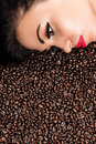 Beautiful woman in coffee beans face of a Stock Photo