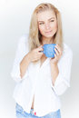 Beautiful woman with coffee cup blond holding blue in hands isolated on white background having morning drink at home Stock Image
