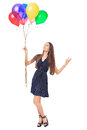 Beautiful woman with colorful balloons full length portrait of happy young in polka dot dress admiring isolated on white Royalty Free Stock Image