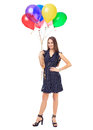 Beautiful woman with colorful balloons full length portrait of smiling young in polka dot dress holding isolated on white Stock Photography