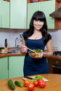 Beautiful woman cooking healthy food Stock Photos