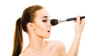 Beautiful woman with cosmetic brushes isolated Royalty Free Stock Photo