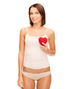 Beautiful woman in cotton underwear and red heart health charity beauty concept showing Stock Images
