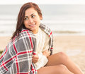 Beautiful woman covering herself with blanket at beach young the Royalty Free Stock Image