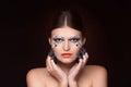 Beautiful woman with crystals makeup keep her hands near face sensual looking at camera Royalty Free Stock Photo