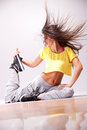 Beautiful woman dancer resting on the floor Stock Images
