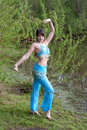 Beautiful woman dances on nature Arabic dances Stock Image