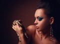 Beautiful woman with dangerous snake portrait of in studio Stock Photos