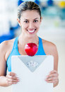 Beautiful woman dieting holding a weight scale and an apple Stock Photos