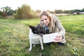 Beautiful woman with dog in taking selfie, nature. Royalty Free Stock Photo
