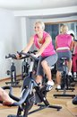 Beautiful woman doing exercise in a spinning class at gym Royalty Free Stock Images