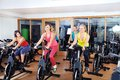 Beautiful woman doing exercise in a spinning class women at gym Stock Photo