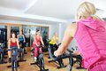 Beautiful woman doing exercise in a spinning class women at gym Royalty Free Stock Photo