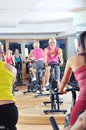 Beautiful woman doing exercise in a spinning class women at gym Stock Image