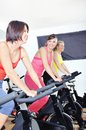 Beautiful woman doing exercise in a spinning class women at gym Royalty Free Stock Photography