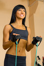 Beautiful woman is doing exercises at the gym Stock Photos