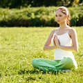 Beautiful woman doing yoga exercises in the park Royalty Free Stock Photos