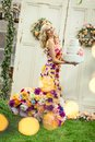 Smiling woman in a dress of flowers with big birthday cake Royalty Free Stock Photo