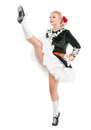 Beautiful woman in dress for Irish dance with leg up isolated