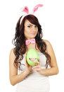 Beautiful woman dressed as rabbit holding egg Royalty Free Stock Image