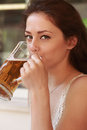Beautiful woman drinking lager beer. Closeup