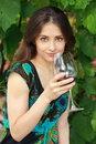 Beautiful woman drinking red wine in park on nature green background Stock Images