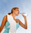 Beautiful woman drinking water during exercising Stock Photo