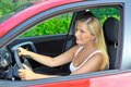 Beautiful woman driver in red shiny car Stock Photos