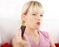 Beautiful woman eating a bar of chocolate Royalty Free Stock Photo
