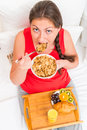 beautiful woman eating breakfast of muesli Royalty Free Stock Photo