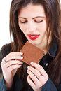 Beautiful woman eating chocolate Stock Photos
