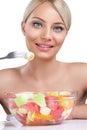 Beautiful woman eating fruit salad young enjoying in Royalty Free Stock Photography
