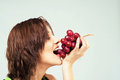 Beautiful woman eating grapes Royalty Free Stock Photo