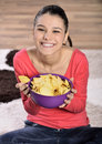 Beautiful woman eating junk food potato chips crisps cute having a snack while Stock Images