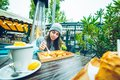 Beautiful woman eating in outside cafe Royalty Free Stock Photo