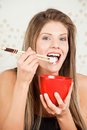 Beautiful woman eating  rice with sticks Stock Photos