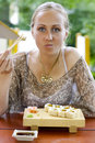 Beautiful woman eating sushi. Royalty Free Stock Photo