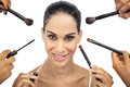 Beautiful woman encircled by make up brushes on white background Stock Images