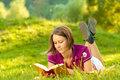 Beautiful woman enjoying a book Royalty Free Stock Photo