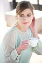 Beautiful woman enjoying a cup of coffee outdoors portrait Royalty Free Stock Photography