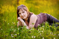 Beautiful woman enjoying daisy field nice female lying down in the meadow of flowers pretty girl relaxing outdoor having fun happy Stock Image