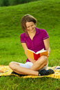 Beautiful woman enjoying a funny book, vertical Royalty Free Stock Photography