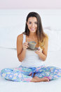 Beautiful woman enjoying morning coffee in bed Royalty Free Stock Photo