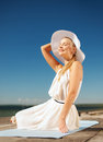 Beautiful woman enjoying summer outdoors fashion and lifestyle concept in hat Stock Photos