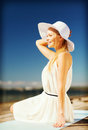 Beautiful woman enjoying summer outdoors fashion and lifestyle concept in hat Royalty Free Stock Images