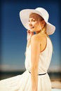 Beautiful woman enjoying summer outdoors fashion and lifestyle concept in hat Stock Images