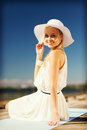 Beautiful woman enjoying summer outdoors fashion and lifestyle concept in hat Royalty Free Stock Photo