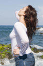 Beautiful woman enjoying with the sun near the sea Royalty Free Stock Photo