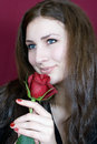 Beautiful woman enjoys scent red roses Stock Photography
