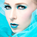Beautiful woman with extreme colorfull make up in turquoise Royalty Free Stock Image